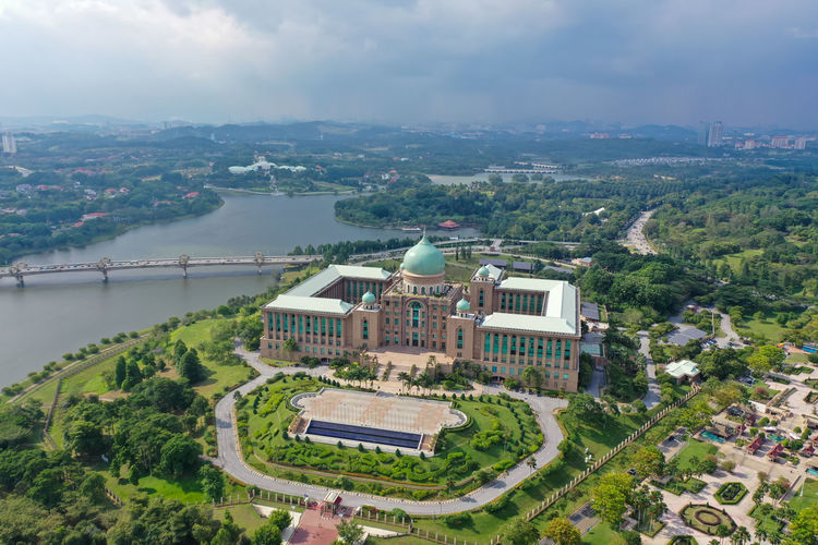 Aerial view of Perdana Putra in Putrajaya with Garden concept and Beautiful Lake Aeriel View Lake Aeriel Image Aeriel Photo Aeriel View Aeriel Shot Aeriel View Lake Perdana Putra Garden City Garden Concept Islamic Architecture Islamic Concept Green Dome Government Centre Putra Square Putra Mosque Putrajaya Lake Tasik Putrajaya Putrajaya Bridge Jambatan Putrajaya Dataran Putra Cityscape Tree Politics And Government City Water Urban Skyline Skyscraper Aerial View High Angle View Sky