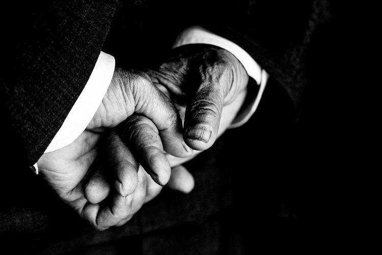 Close-up of man hands against black background