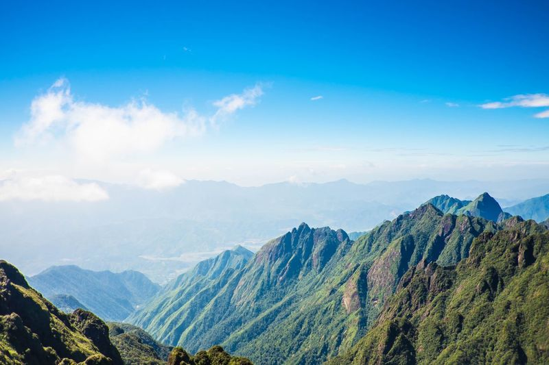 mountain and blue sky at Sapa Sunny Outdoor View Vietnam Vacation Blue Sky Sky Scenics - Nature Mountain Beauty In Nature Cloud - Sky Tranquil Scene Mountain Range Landscape Nature Plant Environment Blue Land