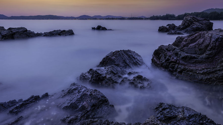 Long exposure of water in sea during sunset
