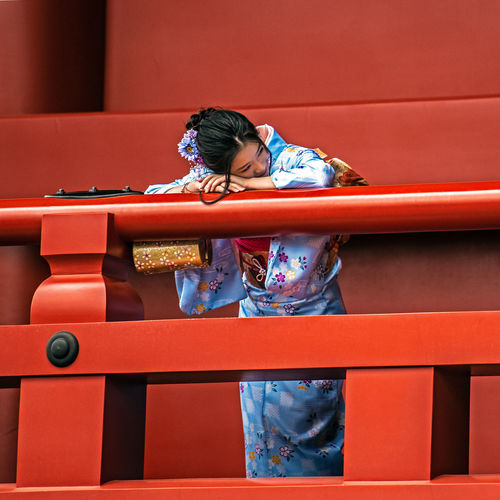 """""""posing for another"""" One Person Lifestyles Real People Leisure Activity Casual Clothing Full Length Women Architecture Girls Railing Innocence Red Color Geisha Geishagirl Temple Japan The Art Of Street Photography My Best Photo The Portraitist - 2019 EyeEm Awards The Portraitist - 2019 EyeEm Awards"""