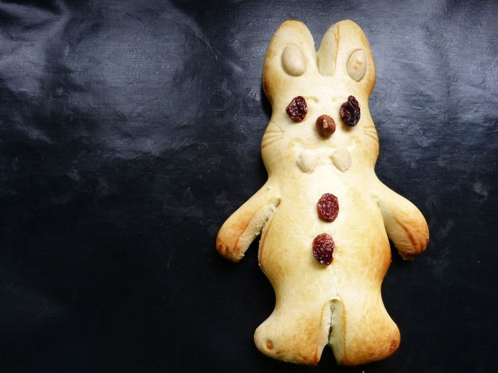 Directly above shot of easter bunny dessert on baking tray