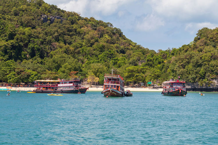 Angthong National Marine Park Thailand Beauty In Nature Cloud - Sky Day Green Color Growth Incidental People Mode Of Transportation Mountain Nature Nautical Vessel Outdoors Passenger Craft Popular Samui_thailand Scenics - Nature Sea Ship Sky Transportation Travel Tree Water Waterfront