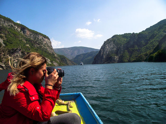 EyeEm Selects Water Mountain Women Lake Photography Themes Photographing Young Women Mid Adult Travel Hiker Calm Hiking Countryside Shore Backpack Idyllic Mountain Range Rocky Mountains Scenics Tranquility Explorer