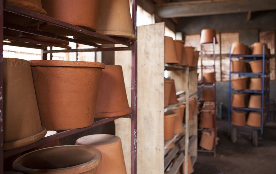 Africa African Business Ceramic Clay Clean Water Day Drying Entrepreneurship Filter Health Indoors  No People Shelves Shelving Social Business Stacked Storage Water Water Filter Workshop