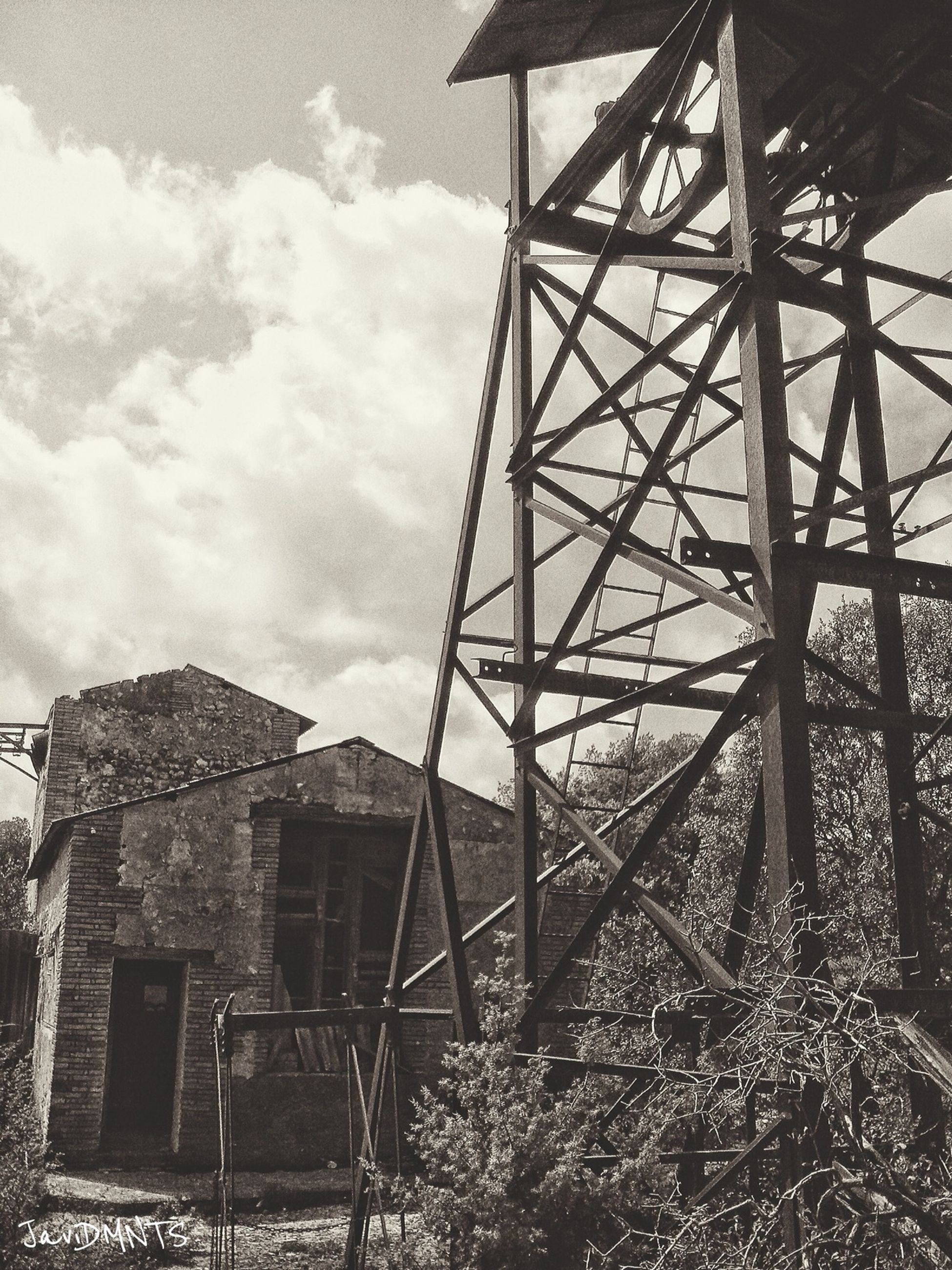 built structure, architecture, sky, cloud - sky, abandoned, building exterior, low angle view, obsolete, metal, cloud, old, damaged, day, cloudy, deterioration, run-down, house, no people, field, outdoors