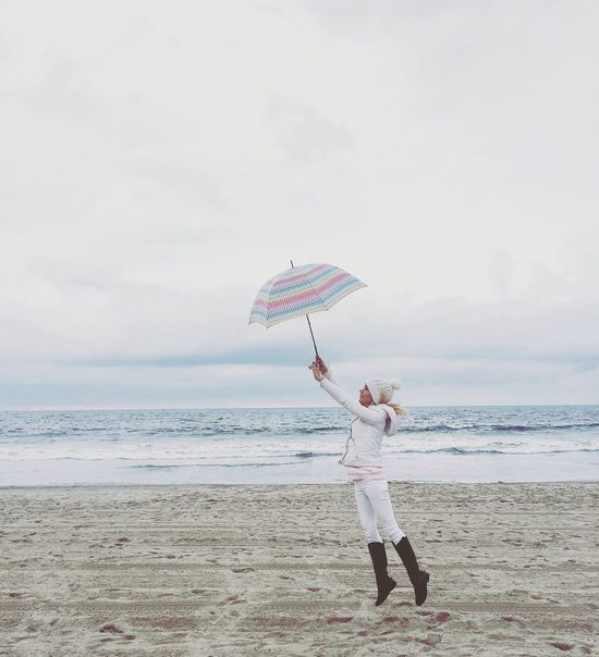 Rainy Days Xmas Holiday Cold Temperature Ocean View Beach Sea One Person Flying Umbrella Girl Girl Power Be. Ready.