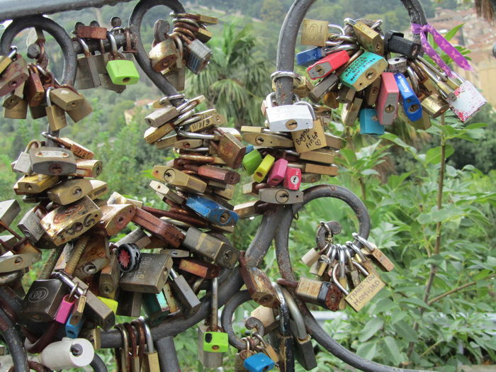 Colorful Padlocks Attached On Railing