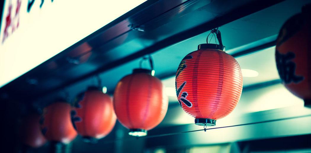 Lanterns at night outside of shop