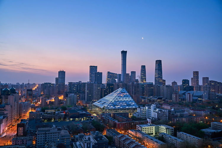 Beijing city skyline at dawn Backlight Beijing Cityscape Moon Office Skyline Skyscrapers Architecture Building Building Exterior Built Structure Business Finance And Industry City Citylife cityscapes Dawn Financial District  Landmark Landscape Night Nightlights Office Building Office Building Exterior Street Sunrise