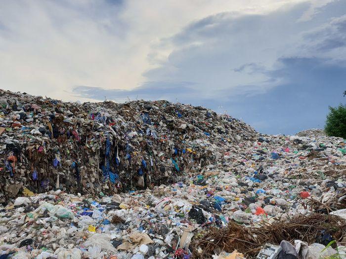 Stack of garbage against sky