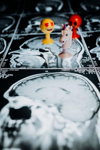 High angle view of figurine over medical x-ray