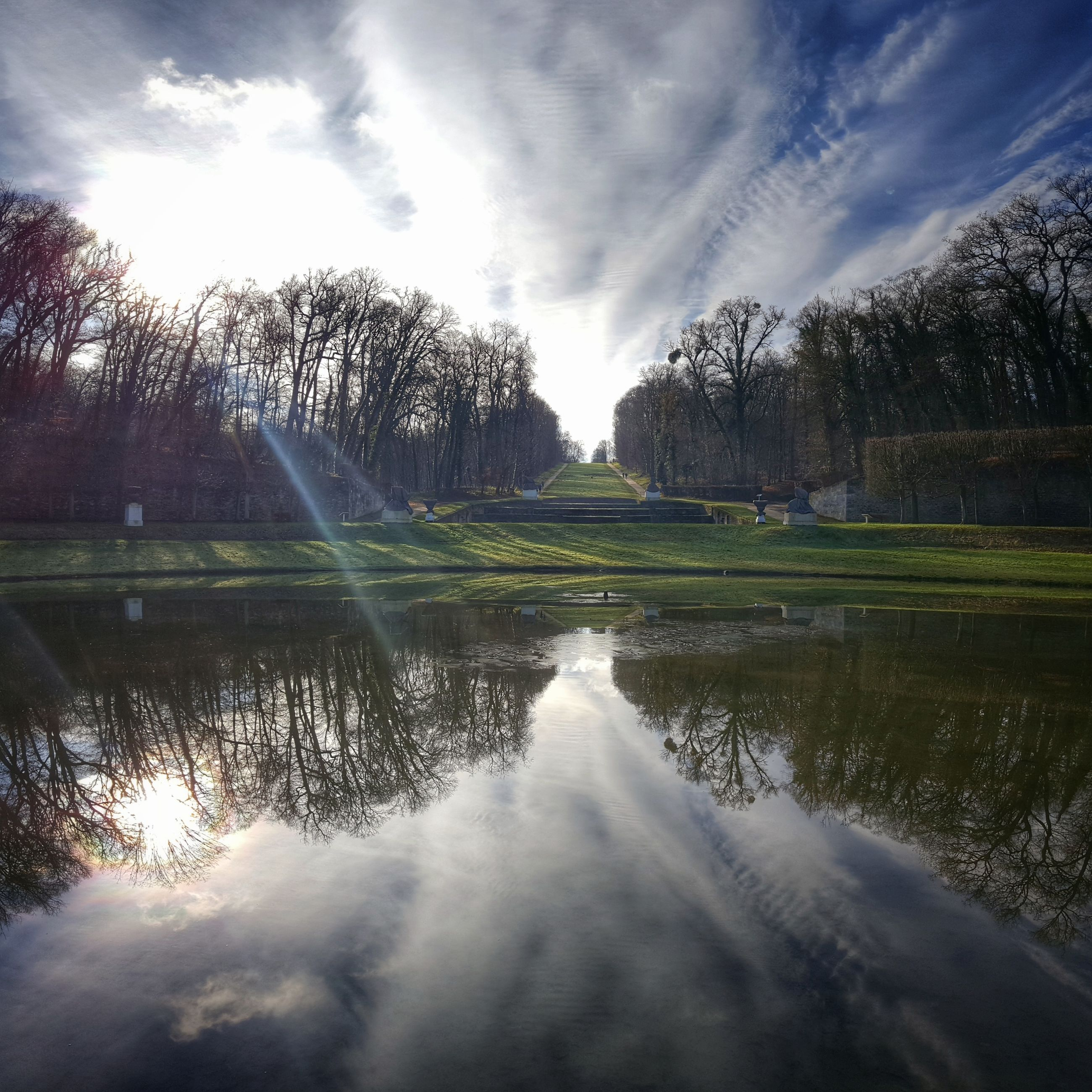 water, reflection, scenics, sky, nature, cloud - sky, beauty in nature, outdoors, tranquil scene, tranquility, lake, motion, day, no people, travel destinations, tree, long exposure, grass, golf course