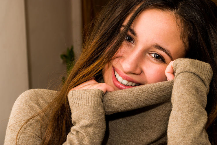 Beatiful , smiling girl looking at camera. Adult Adults Only Beautiful People Beautiful Woman Beauty Brown Hair Cheerful Happiness Headshot Indoors  Lifestyles Long Hair Looking At Camera One Person One Woman Only One Young Woman Only Only Women Portrait Real People Smiling Sweater Warm Clothing Women Young Adult Young Women
