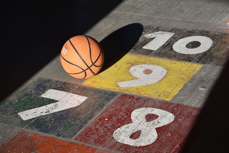 High angle view of basketball ball on numbered court