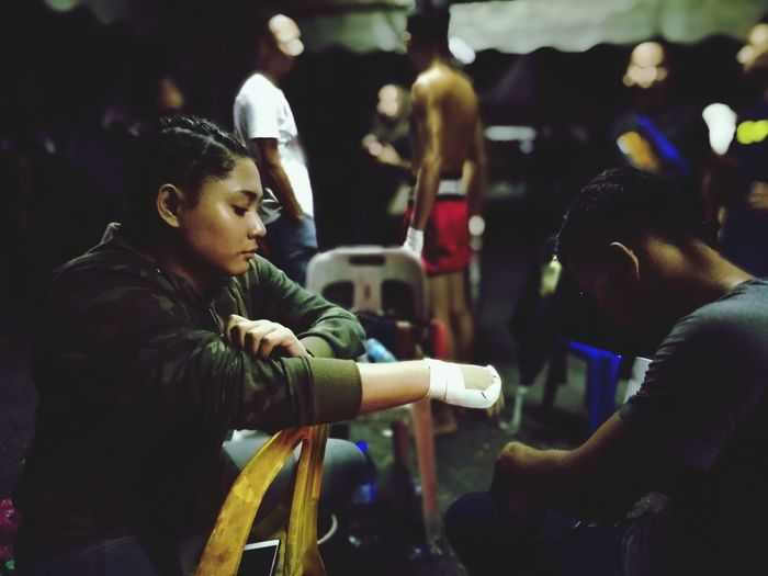 Pre Fight prep, BUFC, Malaysia. NotYourCliche #NotYourCliche EyeEm Best Shots EyeEm EyeEmMalaysia EyeEm Malaysia EyeEmInMalaysia People Adult Night Indoors  Adults Only Only Women Young Adult