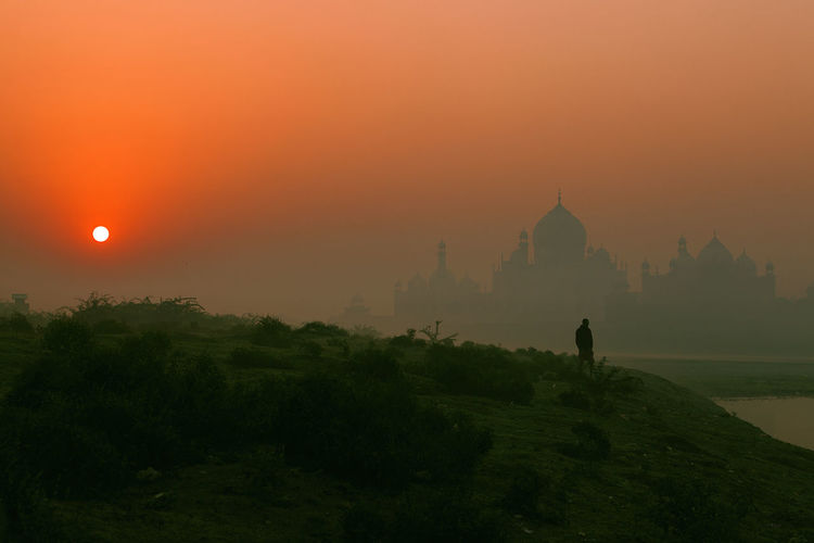 Lost in Agra 43 Golden Moments Adventure Club Beauty In Nature Fine Art Photography Non-urban Scene On The Way Orange Color Outdoors Remote Scenics Silhouette Sun Sunrise Taj Mahal Tourism Tourist Attraction  Tranquil Scene Tranquility Travel Destinations Travel Photography Unrecognizable Person Yamuna River People And Places My Year My View