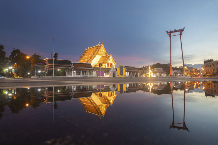 Reflection of buildings in city at waterfront