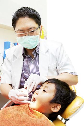 Dentist examining dental health in hospital