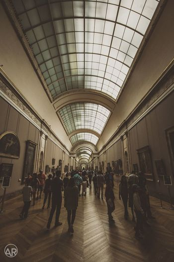 Inside Louvre, Paris Large Group Of People Ceiling Indoors  Real People Travel Men Women Lifestyles Travel Destinations Passenger Public Transportation Crowd Architecture Commuter People Day Adult Louvre Museum Paris France
