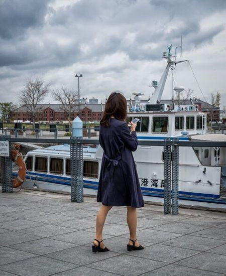 Stormy Times Japan Japanese  Japan Photography Yokohama Street Street Fashion Street Style Streetphotography Colorphotography Fashion Style Urban City People Candid Woman Clouds Boat Xpro2 Fujixpro2 FujifilmXPro2 Xf35mmf2 Cooljapan
