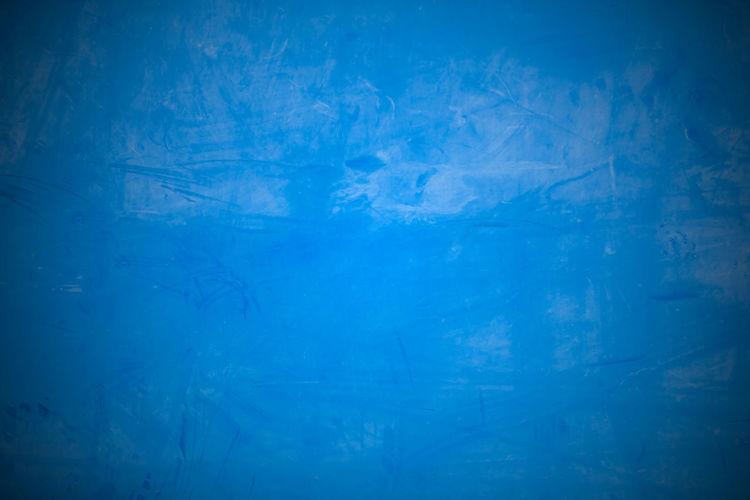 Full frame shot of frozen blue wall