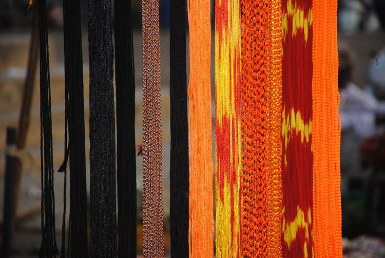 Close-up of multi colored thread hanging at market stall