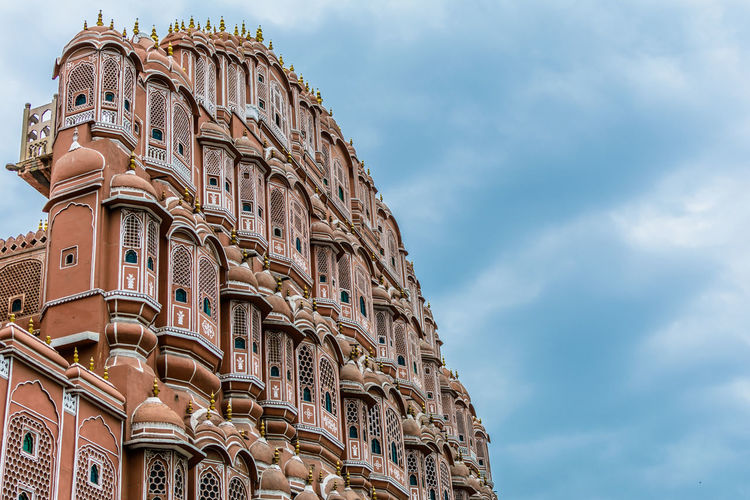 Low angle view of hawa mahal against blue sky