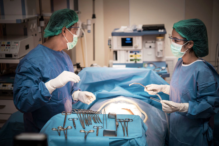 Surgeons Performing Operation On Patient At Hospital