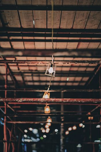 Low angle view of illuminated hanging light