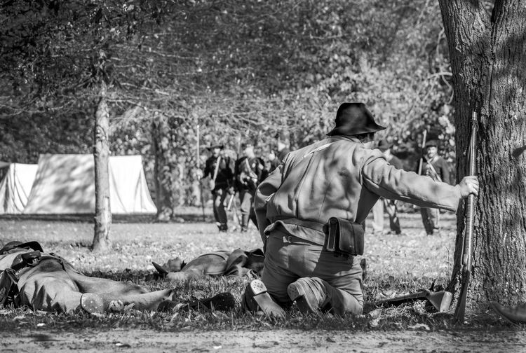 confederate and union soldier recreate a battle during a civil war event in Michigan USA Adults Only Civil War Event North And South Army Soldier Blacka Nd White Confederate Soldiers Full Length Guns Mammal Men Military Military Uniforms Nature Outdoors People Real People Reenactors Tree Union Soldiers Uniroms War Weeopons The Photojournalist - 2018 EyeEm Awards