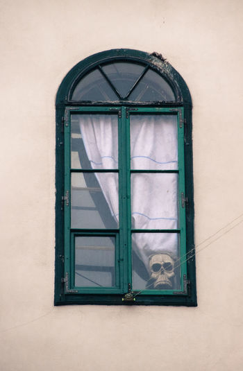 Close-up of window with skull