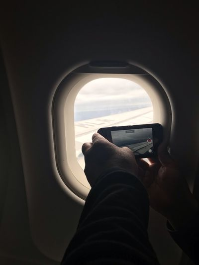 Taking pictures Mode Of Transportation Vehicle Interior Transportation One Person Real People Air Vehicle Airplane Travel Window Lifestyles Journey Men Flying Sky Nature Outdoors Day