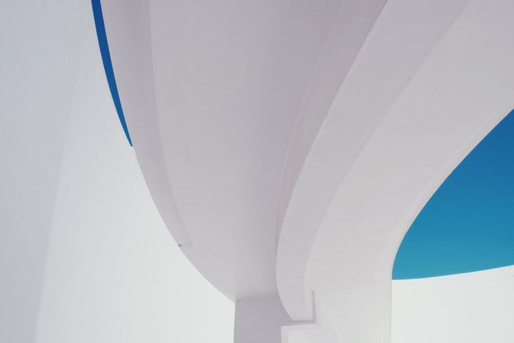 Low Angle View Of White Bridge Ceiling Against Clear Blue Sky