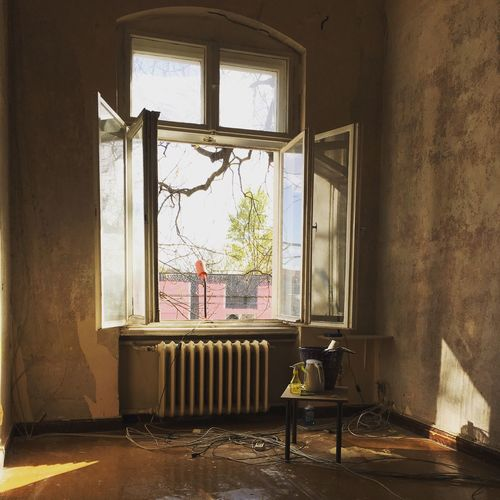 Open window and radiator in old building