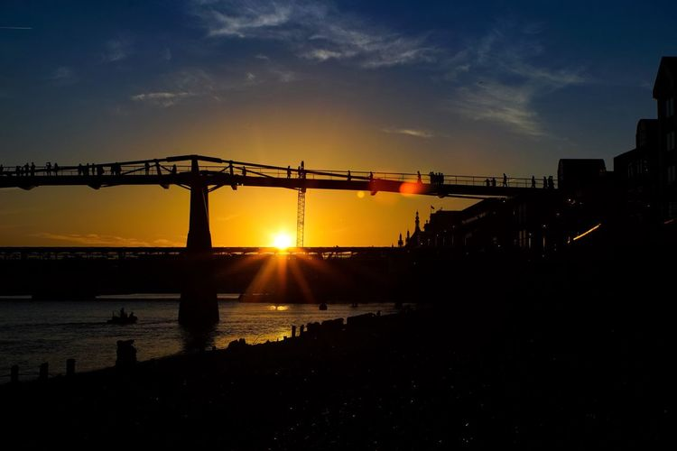 Postcode Postcards Sunset Sky Silhouette Sun Built Structure Architecture Sunlight Bridge - Man Made Structure Water Outdoors No People Travel Destinations Sea Building Exterior Scenics Nature Industry City Day