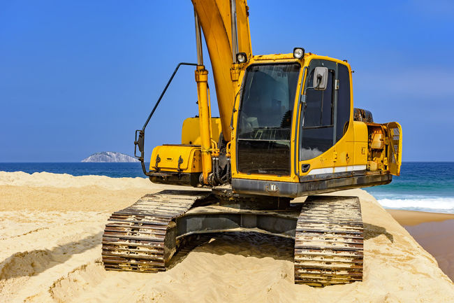 Yellow excavator cabin and arm over sand at beach in a sunny day Buldozer Heavy Tractor Beach Cabin Construction Equipment Construction Industry Construction Machinery Construction Vehicle Crane Day Earth Mover Earthmover Engineering Industry Machinery Mode Of Transportation No People Outdoors Sand Sky Sunlight Transportation Work Tool Yellow