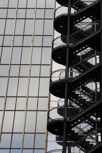 Architecture Built Structure Building Exterior Low Angle View Sky No People Outdoors Day Metallic Tower Architectural Feature Architecture City Full Frame Metal Hanging Out Enjoying Life Taking Photos Check This Out Stairs Emergency Exit Emergency Stairs Windows Architecture_collection Architectural Detail