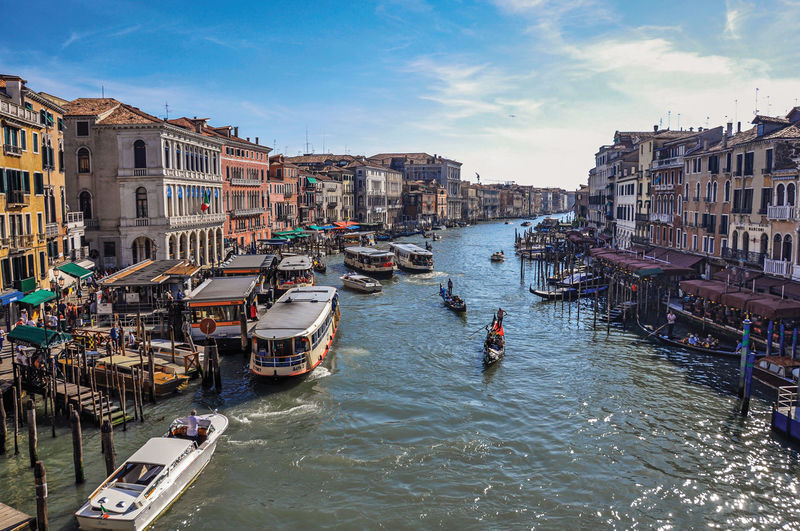 Overview of buildings and gondolas in the canal grande of venice, italy