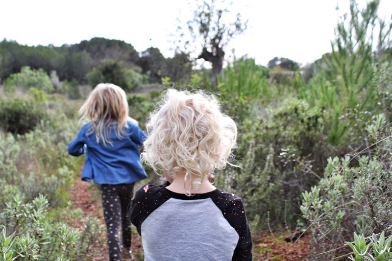 Rear view of child walking