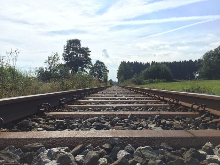 Track Rail Transportation Railroad Track Tree Sky Transportation Plant Cloud - Sky The Way Forward Nature Direction Solid Diminishing Perspective Day No People Rock vanishing point Gravel Stone - Object Metal Outdoors Straight Surface Level Long Pebble