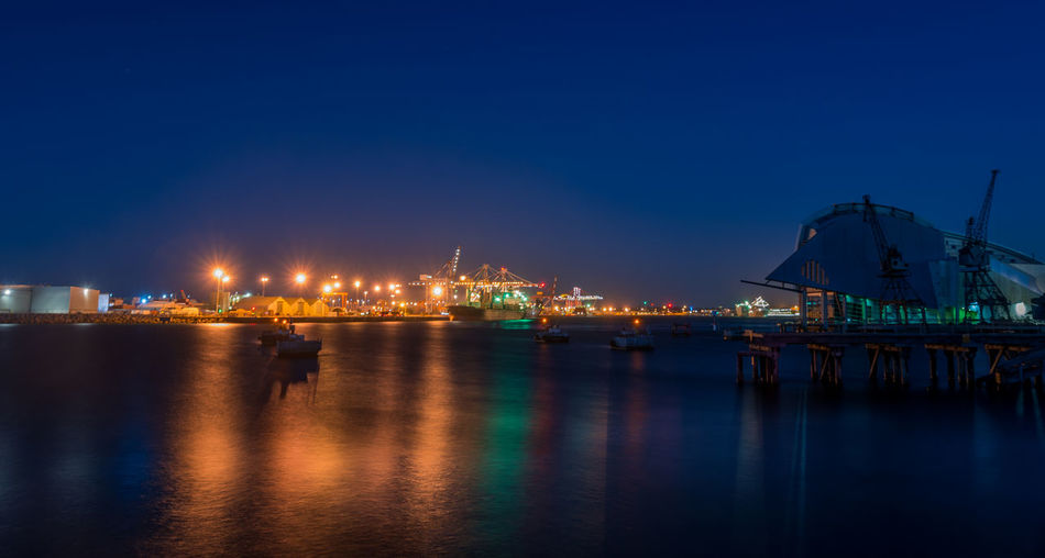 Fremantle dock at night Blue Built Structure Cargo Container Clear Sky Commercial Dock Container Ship Crane - Construction Machinery Freight Transportation Harbor Illuminated Industry Nautical Vessel Night No People Outdoors Pier Reflection Sea Ship Shipping  Shipyard Sky Transportation Water Waterfront