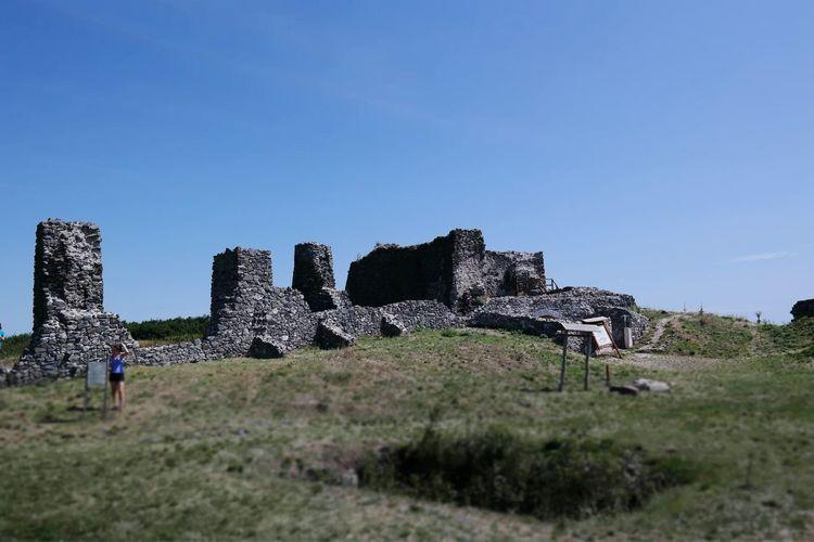 Old Ruin Castle On Field Against Sky