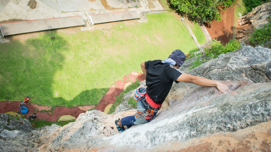 Rock climbing at Batu Caves, Selangor, Malaysia Climber Nature RISK Adventure Belayer Big Wall Cliff Climbing Danger Hand Height High Angle View Men Multipitch Outdoor Photography Outdoors Photography Portrait Rock Climber Rock Climbing