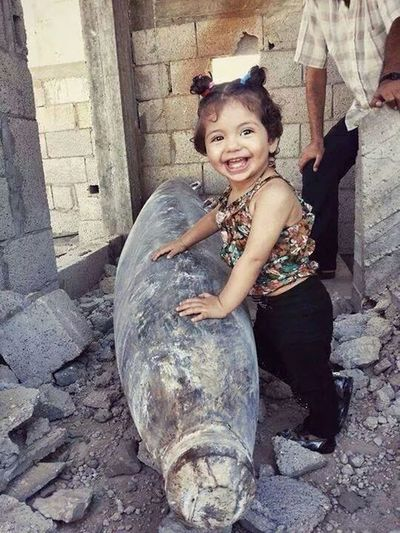Here name is gaza.. Still Smiling(: Gaza Children PrayForGaza Check This Out