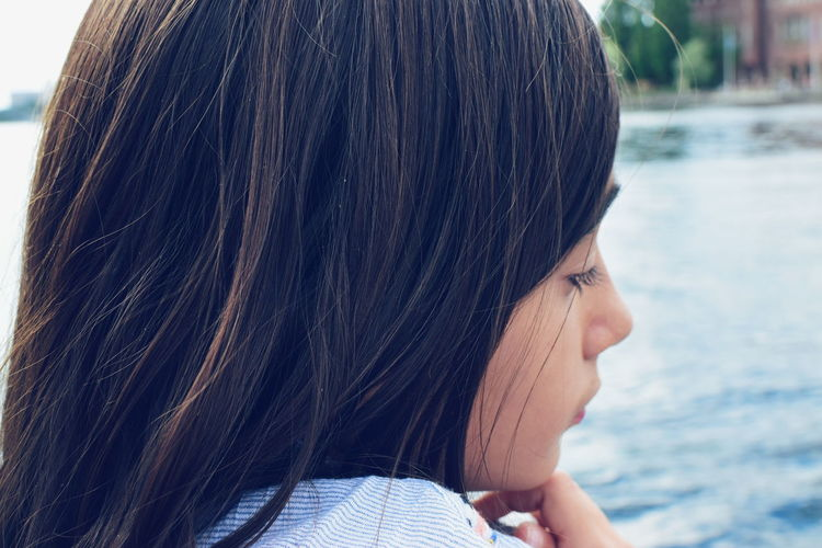 Close-up of thoughtful girl outdoors