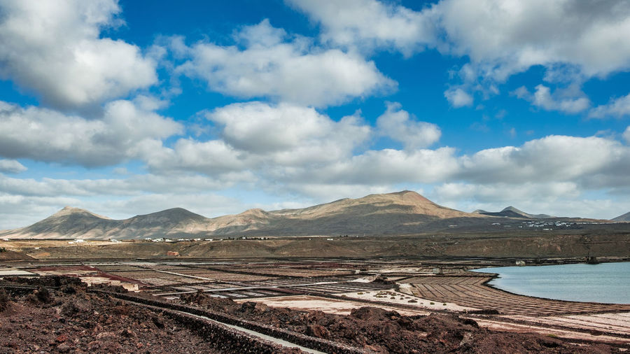 The salinas de janubio in the south of lanzarote. mountain against sky