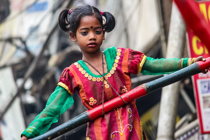 The Street Photographer - 2017 EyeEm Awards One Person Child Traditional Clothing Portrait Outdoors Childhood Working Hard Adventure Poorpeople Poor Girl Uneducated Indian Memorable Moment Photography Flying High Love