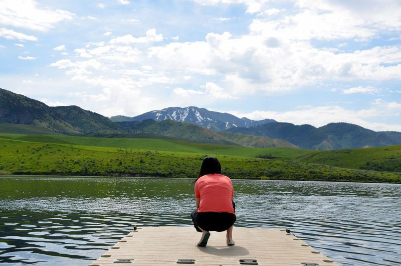 Cloud - Sky Dock On A Lake Idaho Falls Idyllic Mountain Landscape Mountains In The Distance Person Crouching Down Photographing Nature Real People Roadtrip View Of Person From Behind The Great Outdoors - 2017 EyeEm Awards