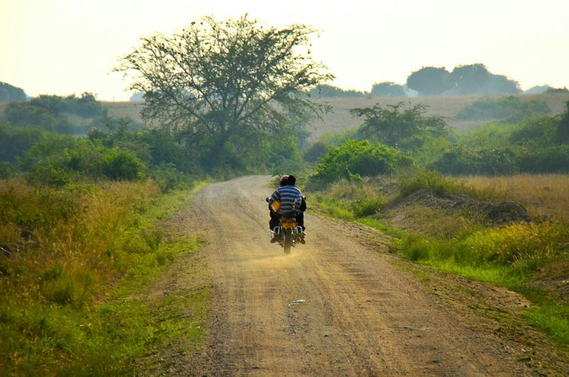 Rear View Of Motorbike On Countryside Road